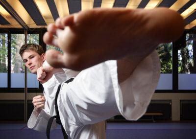 sportportret taekwondo schop Mitchel Bakker